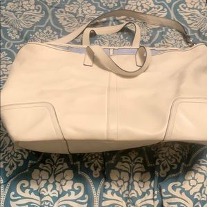Coach, white leather pocket book with wristlet